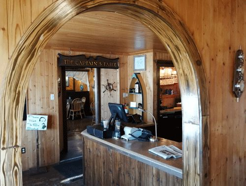 Captain's Table has a rustic atmosphere, reminiscent of a ship's galley